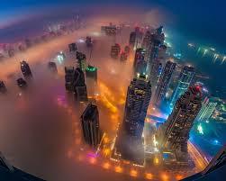 dubai in fog night photograph from air united arab emirates