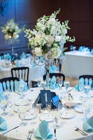 Tiffany Blue Wedding Centerpiece Ideas by A Tiffany Blue And White Table Setting With High Silver Candelabra