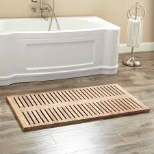 bathroom hexagona tile floor with cozy teak shower mat and