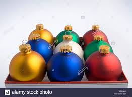 desaturated tree bulb ornaments in happy holidays box