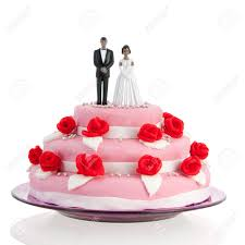 black couple on top of pink wedding cake with red roses isolated