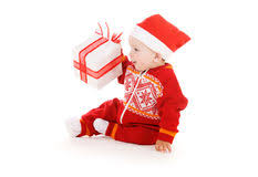 santa helper baby with christmas gift royalty free stock