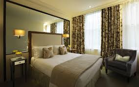 bedroom decor lounge chair wall light upholstered headboard