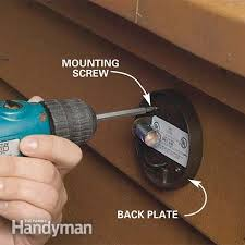 outdoor light back plate how to install deck lighting the family handyman