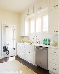 Ivory Colored Kitchen Cabinets Ivory Kitchen Cabinets With Farm Sink And Louvered Window Shutters