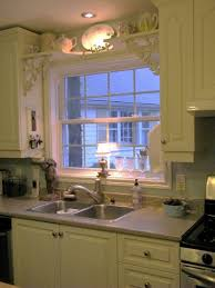 small bay window above kitchen sink gray cut pile rug gray tile