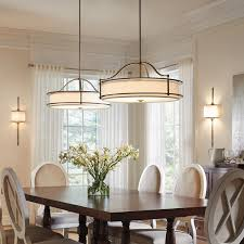 twin contemporary dining room pendant light fixtures over a wooden