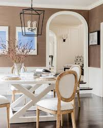 black lantern with round white dining table transitional