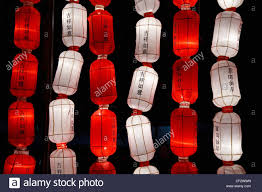 luck lanterns and white lanterns saying luck in the