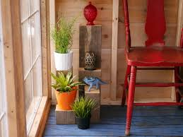 diy scrap wood plant stands in a salvaged material greenhouse