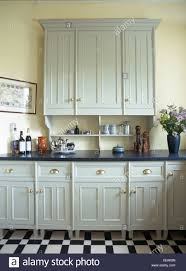 grey kitchen cupboards with black worktop black worktops high resolution stock photography and images