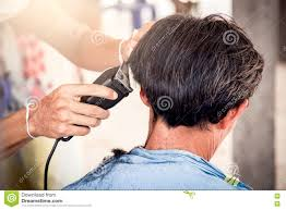 old man having a haircut with a hair clippers stock photo image