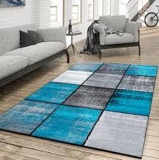 wohnzimmer türkis teppich wohnzimmer modern kariert meliert grau schwarz türkis