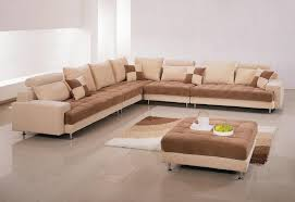 black leather sofa with brown cushions also carpet on
