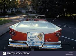 ford convertible 1950s just married sign on back of ford convertible car stock