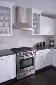 kitchens white cabinets steel gray granite carrara marble back