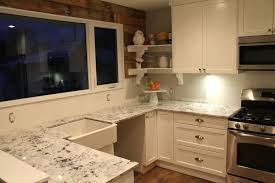 Wood Backsplash Ideas by Granite Countertop White Wood Cabinet Doors Faux Tin Backsplash