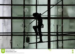painting on glass windows silhouette of man painting on green glass window wall with paint