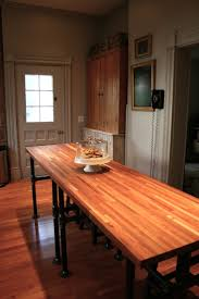 57 best dinning room images on pinterest pipe lighting butcher block island with iron pipe