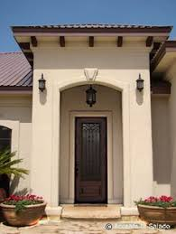paint colors arched entrance dark windows lake house living