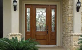 furniture brown wooden door with glass ornament and black iron