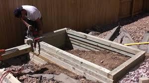 building a raised vegetable garden planter landscape contractors