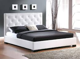 twin size waterbed frame brown comforter and white pillowcase on