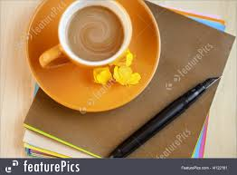 brown writing paper photo of orange coffee cup on brown writing paper with pen orange cup of coffee on brown writing paper with pen view from above