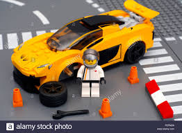 speed chions mclaren driver minifigure near his car mclaren p1 with broken wheel by