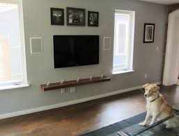 hide tv cables above fireplace sliding panels hide the tv when