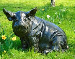 outdoor garden ornament metal pig sculpture candle and blue