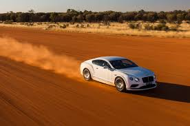 orange bentley against the tide at 200 mph in a bentley continental gt speed