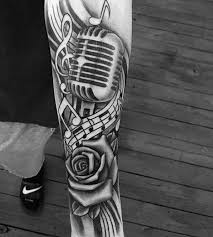 50 music staff tattoo designs for men musical pitch ink ideas