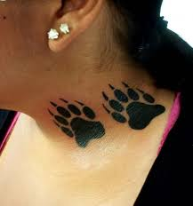small wolf paw tattoos on neck for women photos pictures and