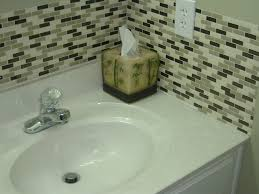 bathroom white sink vanity with brushed nickel faucet and mosaic