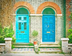 pair of blue front doors of victorian houses in the uk stock photo