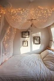 ways to hang christmas lights indoors or hang christmas lights behind sheer curtains for a luminescent