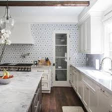 Ivory Colored Kitchen Cabinets Ivory Kitchen Cabinets With Gray Flower Mosaic Tile Backsplash