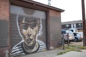 urban reno art adding beauty deterring graffiti kunr the first mural painted by artist joe c rock a portrait of a child on the garage door in an alley in midtown