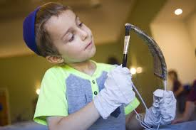 shofar factory workshop helps children learn about rosh hashanah traditions