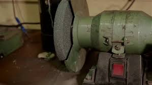 Old Bench Grinder Sharpening Old Axe Tool On Electrical Grinder Stone Stock Footage
