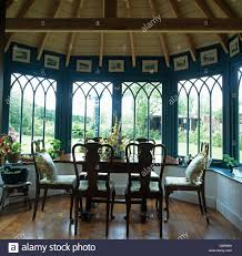 Antique Table And Chairs In Front Of Bay Window In Dining Room - Dining room with bay window