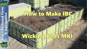 How To Make Self Watering Planters by Wicking Beds How To Make Ibc Self Watering Garden Beds Mki Youtube