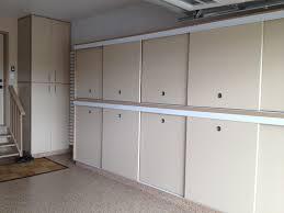 tall garage storage cabinets slotwall epoxy floor custom cabinets sliding doors tall garage