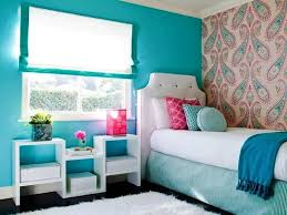 small teenage bedroom decorated with paisley wallpaper and