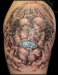 twin baby angel tattoo design photos pictures and sketches