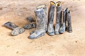 dirty riding boots dirty riding boots standing at muddy ground stock image image of