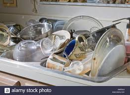 Dirty Dishes Piled Up In The Kitchen Sink Stock Photo Royalty - Dirty kitchen sink