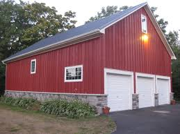 gambrel roof garages barn garage refinished with board and batten metal roof with