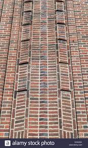 close up of decorative red brick facade of an art deco building